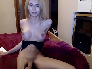 Slim hottie strokes cock