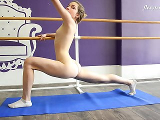 Zealous flexible hottie Julia Fiatal flashes titties and nice bum as she does stretching