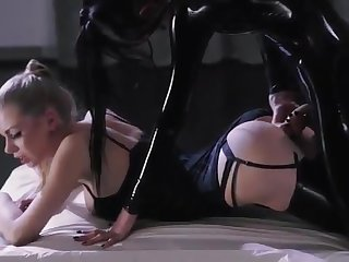 A handful of leather-clad lesbians strapon intercourse video