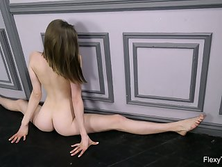 Russian babe Klara Lookova does the splits and shows off yummy pussy in all its greatness