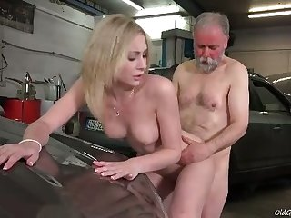 Awesome sexy blonde chick rides older man's strong cock in get under one's garage