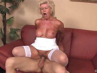 Mature granny Effie gives a titjob and rides their way younger lover