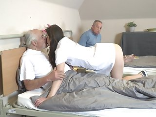 Young nurse Nana Garnet is sucking hard dicks be beneficial to two pensioners